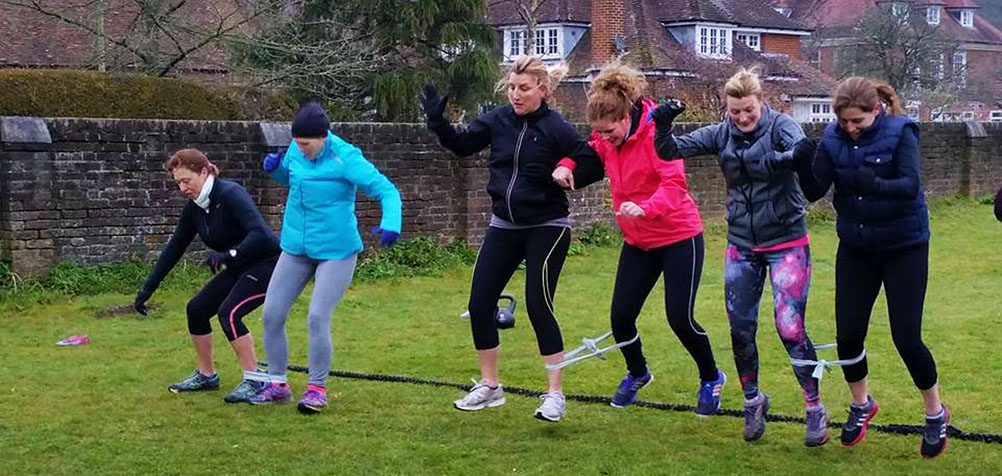 Three legged race at Moyles Court in the New Forest Hampshire doing personal training