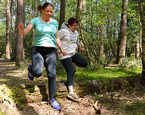 jumping a log in the new forest while excercising